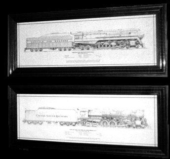 Framed technical drawings of locomotives by artist Bill Berkompas